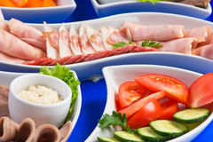 Assorted sausages and vegetables Stock Photography