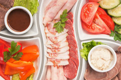Assorted sausages and vegetables Stock Images