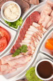 Assorted sausages and vegetables Royalty Free Stock Images