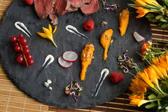 Assorted savoury holiday snacks on plate Stock Photo