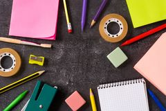 Assorted of school supplies on black slate. Back to school concept. Top view royalty free stock photos