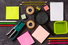 Assorted of school supplies on black slate. Back to school concept. Top view stock image
