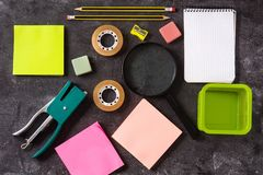Assorted of school supplies on black slate. Back to school concept. Top view royalty free stock images