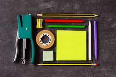 Assorted of school supplies on black slate. Back to school concept. Assorted of school supplies pattern on black slate.Top view.  Back to school concept royalty free stock photo