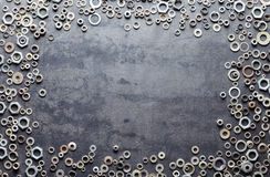 Assorted screw nuts and bolts frame on metal background Stock Photo