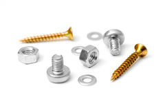 Assorted nuts, screws and washers. Assorted screws, nuts and washers close up. Selective focus, screws in various colors royalty free stock images