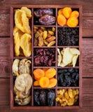 Assorted secó las frutas en caja de madera Fotos de archivo libres de regalías