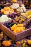 Assorted secó las frutas en caja de madera Imágenes de archivo libres de regalías