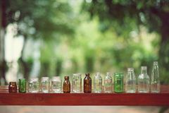 Assorted series collection of empty transparent glass bottle container in white, green and brown color, container reuse concept. Copy space royalty free stock photos