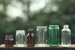 Assorted series collection of empty transparent glass bottle container in white, green and brown color, container reuse concept. Eco friendly concept royalty free stock photo