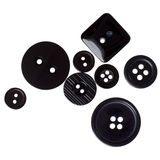 Assorted shiny black clothes buttons isolated Royalty Free Stock Photography