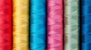 Assorted shiny sewing threads - background Royalty Free Stock Images