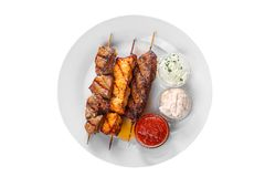 Assorted shish kebab plate isolated on white stock photography