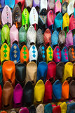 Assorted shoes at market stall royalty free stock photography