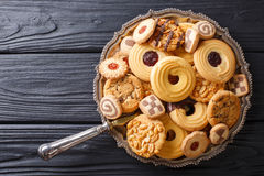 Assorted shortbread cookie close-up on a plate. vertical view fr. Assorted shortbread cookie close-up on a plate on a table. vertical view from above Royalty Free Stock Photos