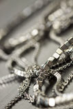 Assorted silver costume jewellery Royalty Free Stock Photography