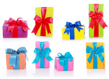 Assorted Sizes and Colors Gift Boxes. With Big Ribbons Isolated on White Background Stock Photos