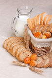 Assorted sliced bakery products and milk Royalty Free Stock Photography