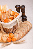 Assorted sliced bakery products and wheat Royalty Free Stock Photography