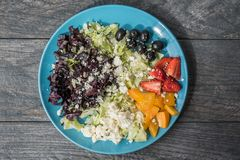 Assorted Sliced Fruits and Vegetables on Blue Ceramic Plate stock photography