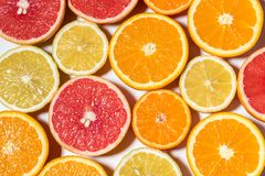 Assorted sliced fruits on white background. royalty free stock images