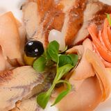 The assorted smoked fish Stock Image