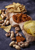 Assorted of snack. Chips, pistachios, nachos and peanuts Royalty Free Stock Photography