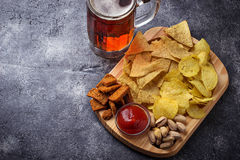Assorted of snack. Chips, pistachios, nachos and peanuts Royalty Free Stock Images