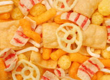 Assorted snacks. Background made of assorted salted snacks Royalty Free Stock Photography