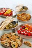 Assorted snacks. For banquet on brown plates stock image