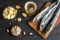 Assorted snacks for beer, dried fish stock images