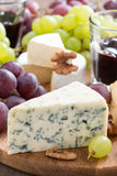 Assorted snacks and red wine, blue cheese, cheddar, camembert Royalty Free Stock Photo