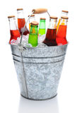 Assorted Soda Bottles in Ice Bucket Royalty Free Stock Photos