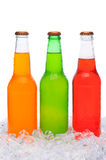 Assorted Soda Bottles Standing in Ice Royalty Free Stock Photography