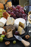 Assorted soft delicacy cheeses and snacks for wine Stock Photography