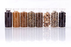 Assorted of spice bottles condiment  . Assorted of spice bottles condiment  black pepper ,white pepper,  black mustard,white mustard,fenugreek,cumin and fennel Royalty Free Stock Photo