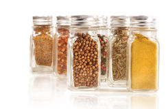 Assorted spice jars isolated on white Royalty Free Stock Photos
