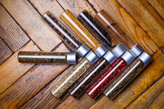 Assorted spices in bottles on wooden background Royalty Free Stock Photo