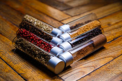 Assorted spices in bottles on wooden background Stock Photography