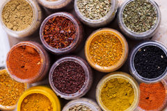 Assorted spices in containers Stock Photography