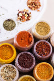 Assorted spices and dry tea in boxes Royalty Free Stock Images