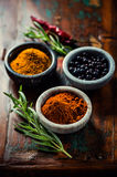 Assorted spices in small containers Stock Photography