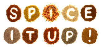 Assorted spices spelling the word: spice it up royalty free stock photo