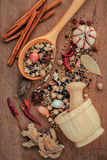 Assorted of spices  in wooden spoon  black pepper ,white pepper, Royalty Free Stock Images