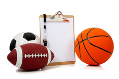 Assorted sports balls with a Clipboard Royalty Free Stock Photography
