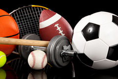 Assorted sports equipment on black Royalty Free Stock Photography