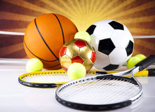 Assorted sports equipment and sunset Royalty Free Stock Photos