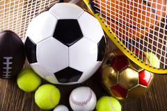 Assorted sports equipment and sunset Royalty Free Stock Photography