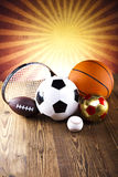 Assorted sports equipment and sunset Stock Photo