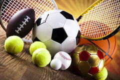 Assorted sports equipment and sunset. Sports Equipment and sunshine, vivid colorful theme Royalty Free Stock Photos